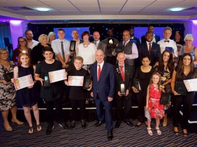 Group of outstanding citizens at awards event